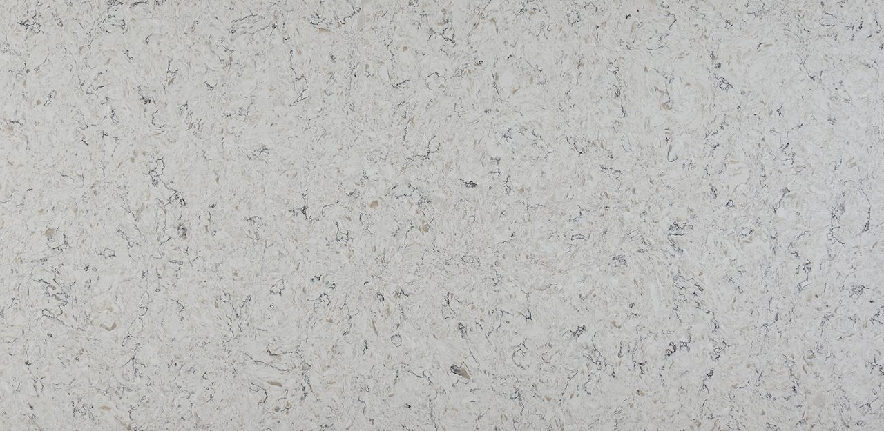 A sample of CRL Quartz's River White, marble resembling surface for kitchens and bathrooms