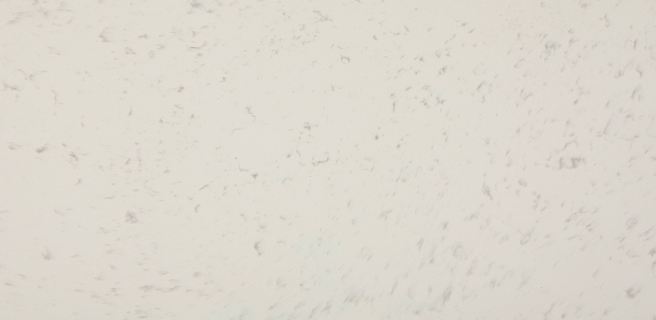 A sample of CRL Quartz's Regency White kitchen and bathroom surface with speckles of faded black
